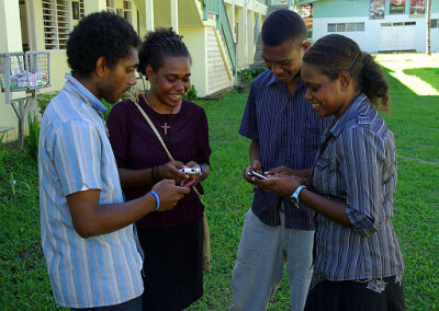 Group_of_young_people_texting_on_mobile_phones._10699648676-400x284.jpg